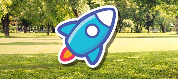 A cartoon rocket overlaid on a photo of a park scene