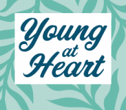 """The words """"Young at Heart"""" against a mint green leafy background pattern"""
